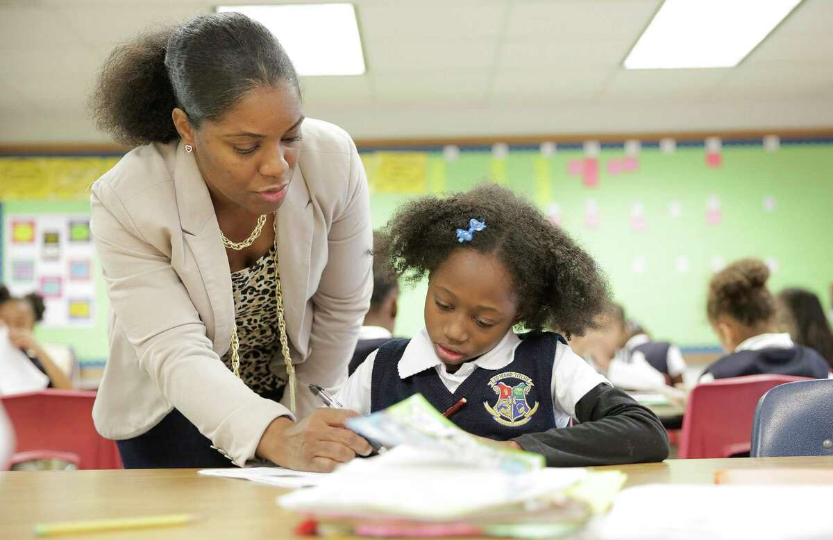 Third grade teacher Natasha Boone, works with Aayahna Carlton on her reading skills at Edward Titche Elementary School in Dallas on Thursday, Nov. 15, 2018. The school became part of the Dallas ISD Accelerating Campus Excellence initiative in 2017-18 and produced stellar academic gains in just one year.