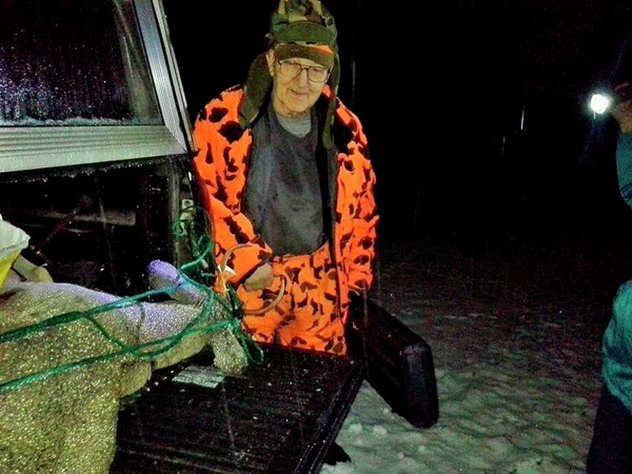 Larry Draves stands with the four-point buck that he harvested on opening day this year -- just four months after finishing chemotherapy treatments for cancer. (Submitted photo)