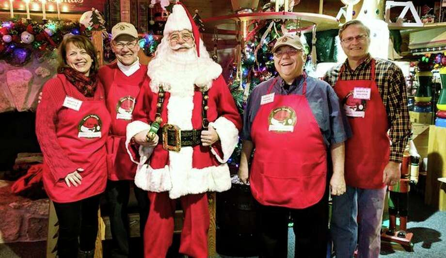 Midland Kiwanis Club elves helped Santa entertain hundreds of children and their parents at Santa's House this Christmas season. They greeted, guided, took family photos and helped all who visited have a grand time. These helping elves are Susan Briggs Sinclair, Kevin Shaughnessey, Randy Ransomand Roger Briggs. Other elves (not pictured) included Ralph Wirtz, Bella Lindaur,Tom Madden, Sue Soper and Earl Soules.(Photo provided/Donna Jo Aiken)