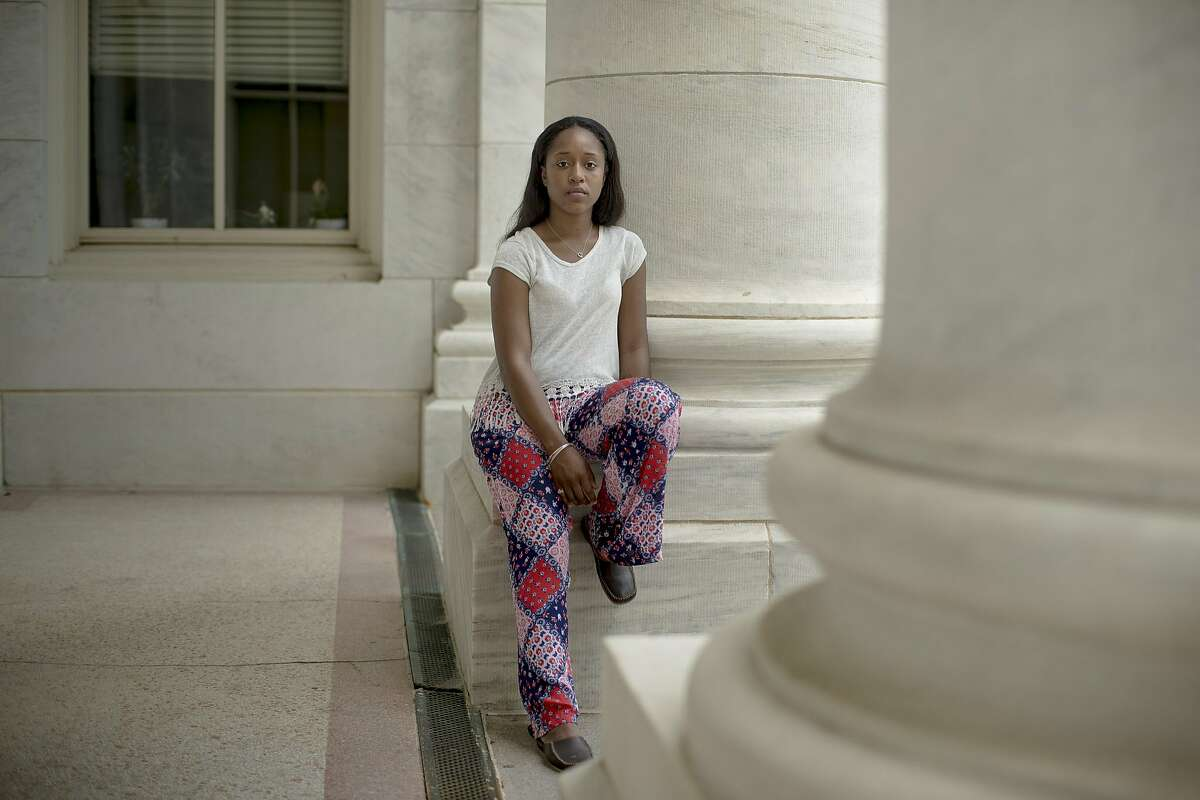 FILE -- Taylor Dumpson, who sued after enduring a racist �troll storm� while she served as American University�s student body president, at American University in Washington, July 4, 2017. As part of the settlement, filed this week, one of Dumpson's harassers has agreed to apologize, renounce white supremacy, undergo counseling and help civil rights groups fight hate and bigotry. (Gabriella Demczuk/The New York Times)