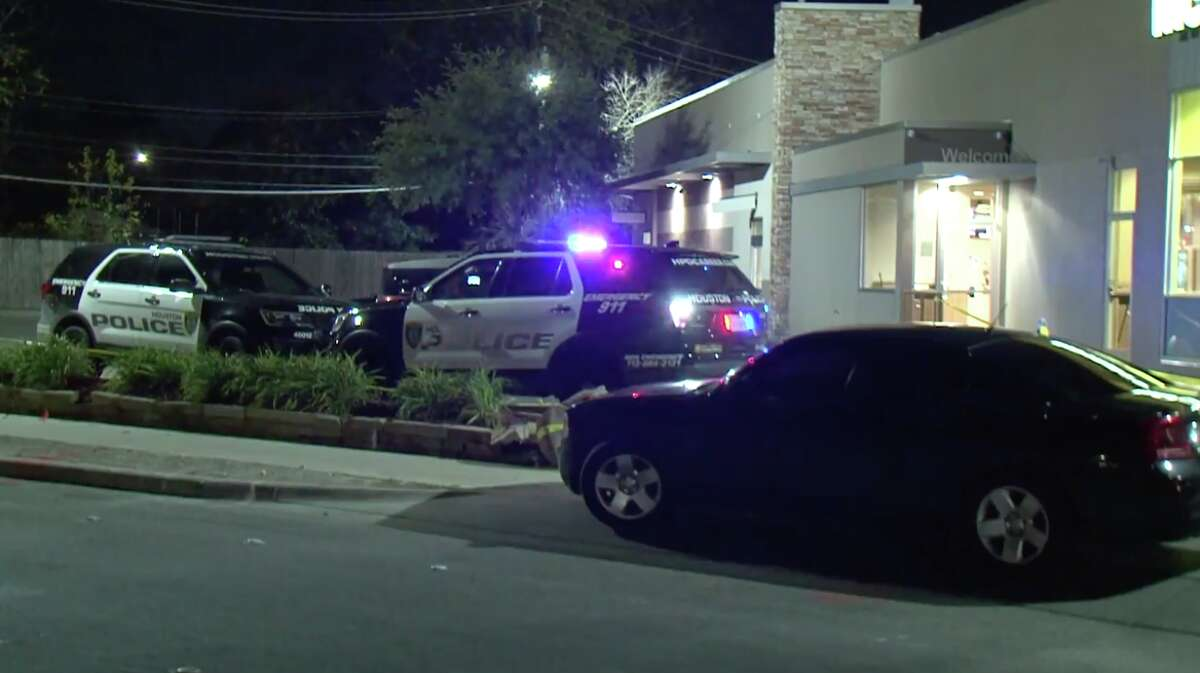 A man trying to rob a McDonald's on the Northwest Freeway was hospitalized after being shot by a customer Friday night.
