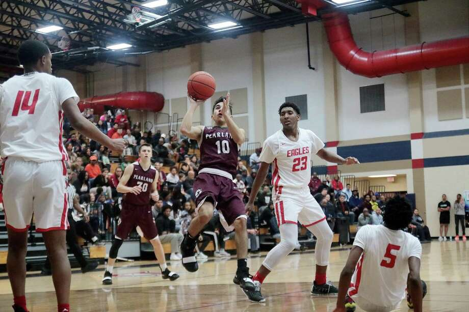 Ethan Flores (10) of Pearland prepares to put up a soft shot in the lane while Dawson's Jordan Marshall (14), Lorenzo Waddy (23) and D.K. Thorn observe. The Eagles won the District 23-6A game, 41-36. Photo: Pin Lim, Freelance / Contributer / Copyright Forest Photography, 2018.