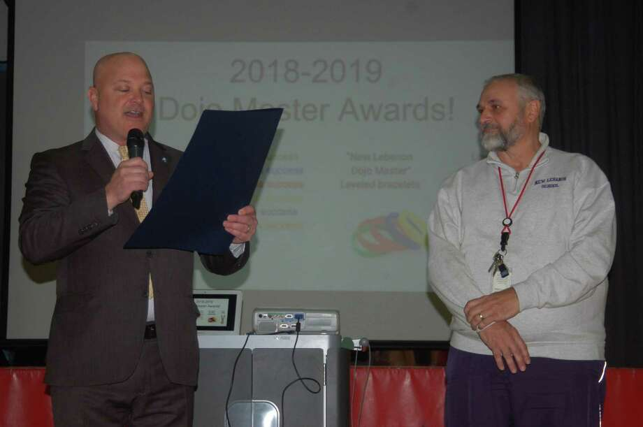 State Rep. Michael Bocchino, R-149, presented a special citation to Mr. New Lebanon, physical education teacher Bob Mata. Mata will be retiring after 42 years at the school in June and he was thanked for his decades of service by Bocchino, who happened to be one of Mata's students back when he was a New Lebanon School student. Photo: Ken Borsuk / Hearst Connecticut Media