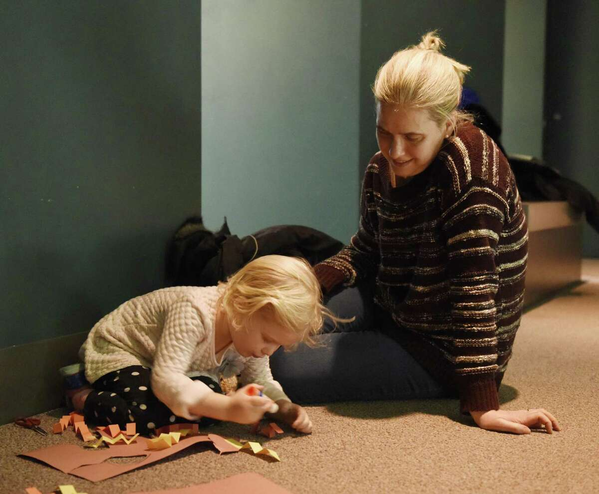 Greenwich's Bailey Haberli, 4, and her mother, Nina, complete a craft at the Bruce Museum in Greenwich last month as part of the Art Adventures program. Kids can visit the museum from 1 to 3 p.m. Sunday to take part in the drop-in program. On Dec. 23, the theme is