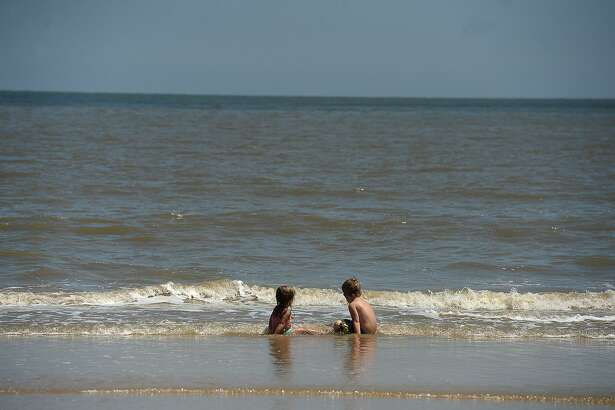 Adalynn Whalen, 2, and Camden Sweat, 5, play near the shore at McFaddin Beach Monday. Dune restoration at the McFaddin National Wildlife Refuge is among the funding items on the agenda for the Commissioners Court. Photo taken Monday, June 1, 2015 Kim Brent/The Enterprise