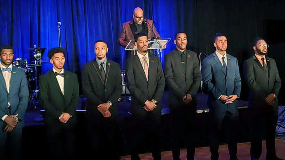Leroy Shumpert, President of 100 Black Men of Metropolitan St. Louis recognizing the SIUE Collegiate 100 Chapter. Listed from Left to Right: Dustin Judge-Hayes, Vernon Smith, Justin Truman, President Braxton McCarroll, Patrick Bowman, Trystin Nance and founding member Reginald Hamilton. Photo: Photos Courtesy Of Darryl Cherry