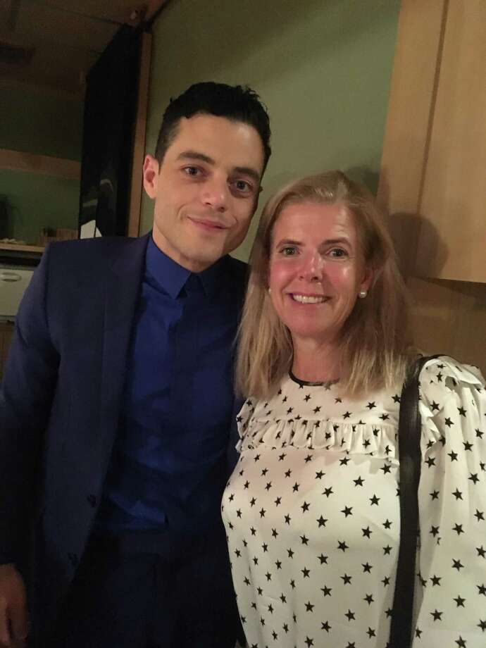 """Riverside resident Kathleen Bellissimo with actor Rami Malek, who plays Queen lead singer Freddie Mercury in """"Bohemian Rhapsody,"""" at the film's Japanese premiere at the Roppongi Hills Theater in Tokyo. Photo: Contributed /"""