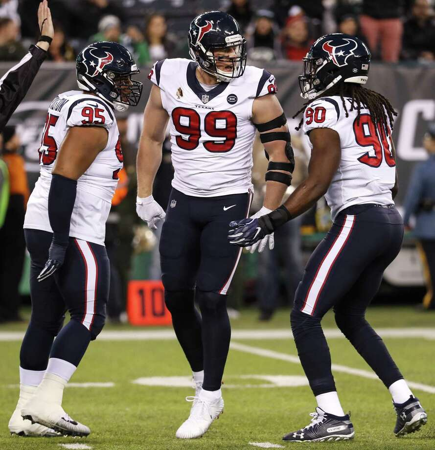 Houston Texans defensive ends Christian Covington (95), J.J. Watt (99) and outside linebacker Jadeveon Clowney (90) celebrate after a Watt sack during the first quarter at MetLife Stadium on Saturday, Dec. 15. Photo: Brett Coomer, Houston Chronicle / Staff Photographer / © 2018 Houston Chronicle