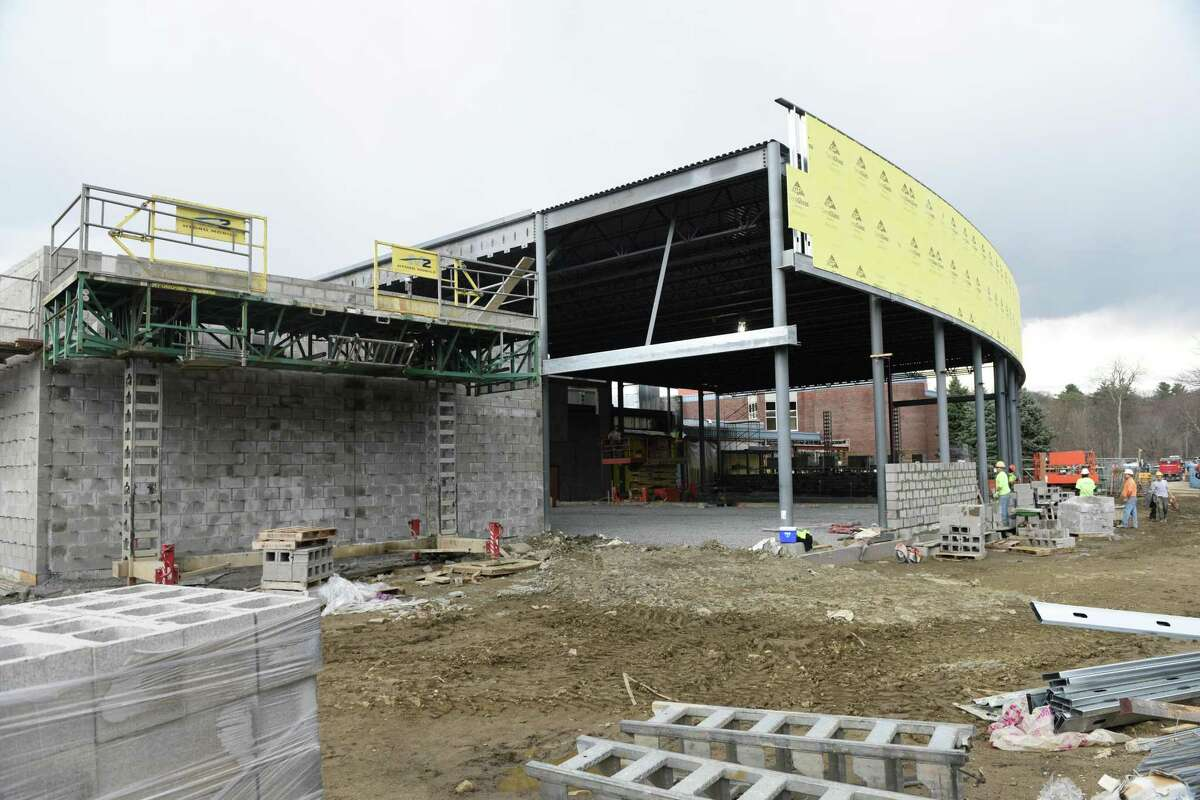 Construction crews work on the new MISA music classrooms at Greenwich High School in Greenwich, Conn. Thursday, March 17, 2016.