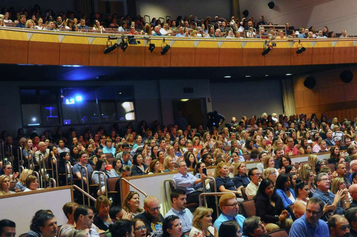 Greenwich teachers filled in the Performing Arts Center of Greenwich High School for the annual convocation ceremony. Photographed in Greenwich, Conn. on Monday, August 28, 2017.