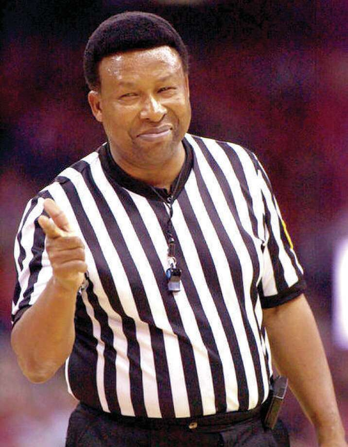 Alton native and former area educator and school administrator Ed Hightower points after calling a foul during his days as one of the top NCAA basketball officials. Photo: AP