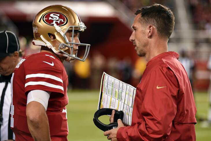SAN FRANCISCO, CA - NOVEMBER 01: San Francisco 49ers Quarterback Nick Mullens (4) in conversation with San Francisco 49ers Head Coach Kyle Shanahan during the NFL football game between the Oakland Raiders and the San Francisco 49ers on November 1, 2018, at Levi's Stadium in Santa Clara, CA. (Photo by Cody Glenn/Icon Sportswire via Getty Images)