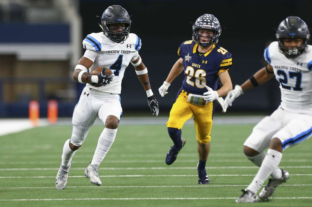 Alvin Shadow Creek defensive back Xavion Alford (4) returns an intercepted pass against Dallas Highland Park during the first quarter of the 5A Division 1 State Championship at AT&T Stadium Saturday, Dec. 22, 2018, in Arlington, Texas. Dallas Highland Park won 27-17.