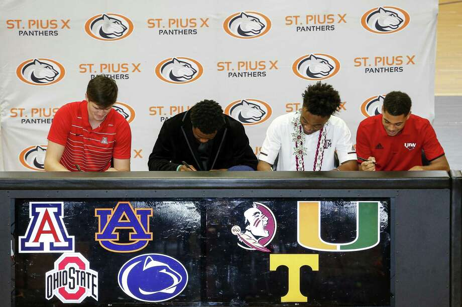 """Grant Gunnell, Jalen """"Boobie"""" Curry, Chase Lane, and Kaleb Ducros sign letters of intent during the Early National Signing Day at St. Pius X High School in Houston on Wednesday, Dec. 19, 2018. Photo: Tim Warner, Houston Chronicle / Contributor / ©Houston Chronicle"""