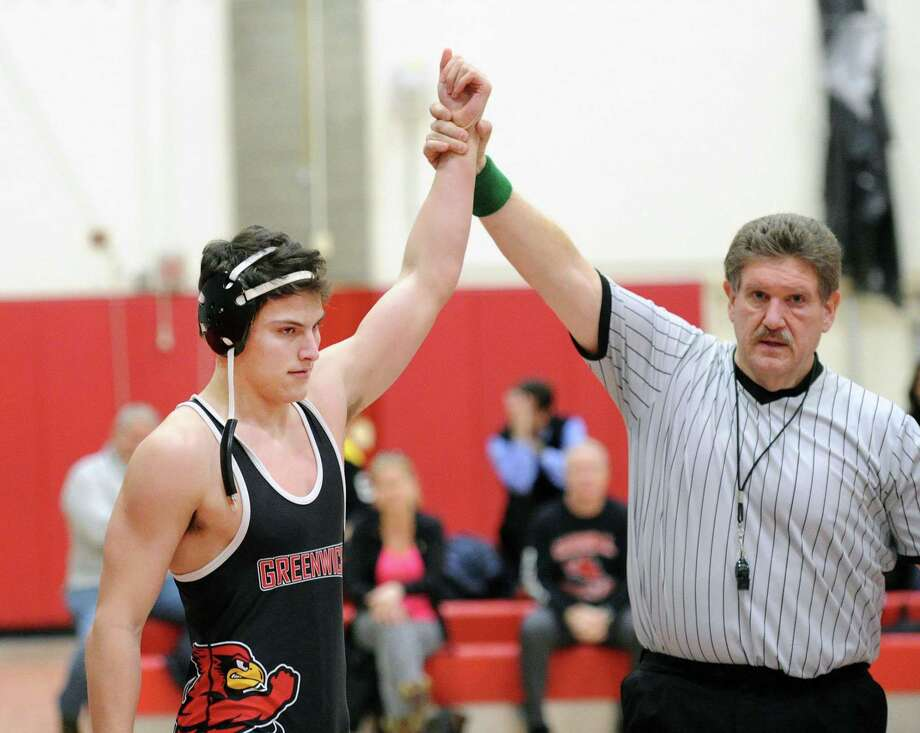 Greenwich's Jackson Blanchard is declared the winner in his 170-pound match against Darien's James Nedder in a match on Feb. 6. Photo: Bob Luckey Jr. / Hearst Connecticut Media / Greenwich Time