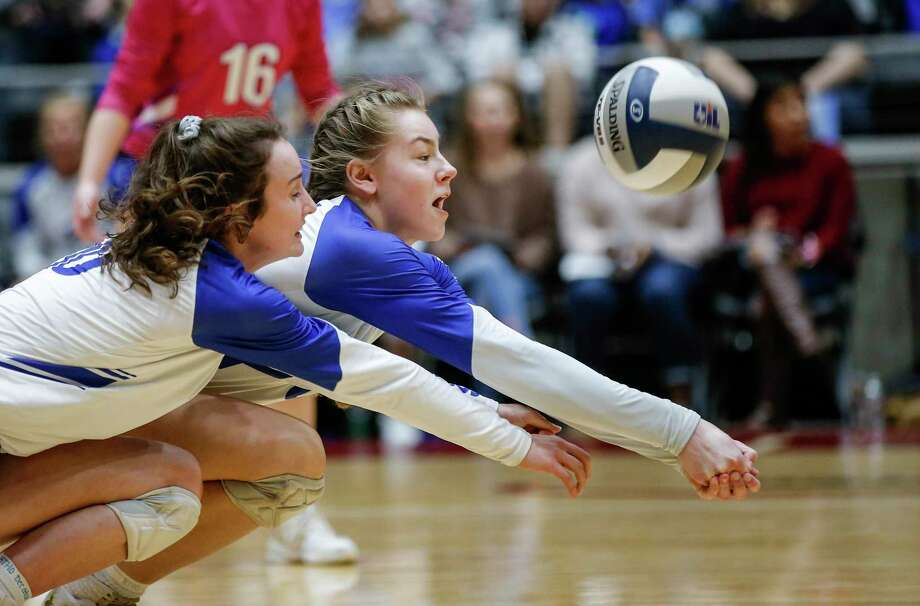 Needville's Maddy Hrncir, foreground, and Madison Schultz dig for the ball during a Class 4A State Championship volleyball game against Decatur at the Curtis Culwell Center in Garland om 2018. Photo: Brandon Wade, STR / SPECIAL/BRANDON WADE / Brandon Wade