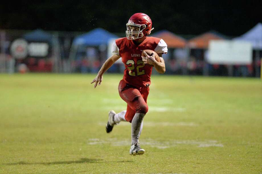 Tommy Loyd (22) of St. John XXIII scores on a pass in the first quarter of a high school football game between the St. John XXIII Lions and the Beaumont Kelly Bulldogs on Friday, October 19, 2018 at St. John XXIII, Katy, TX. Photo: Craig Moseley, Houston Chronicle / Staff Photographer / ©2018 Houston Chronicle