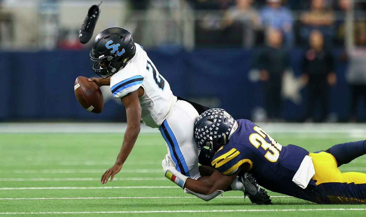 Alvin Shadow Creek quarterback Jamarian George (2) is sacked by Dallas Highland Park defensive lineman Prince Dorbah (32) during the fourth quarter of the 5A Division 1 State Championship at AT&T Stadium Saturday, Dec. 22, 2018, in Arlington, Texas. Dallas Highland Park won 27-17.