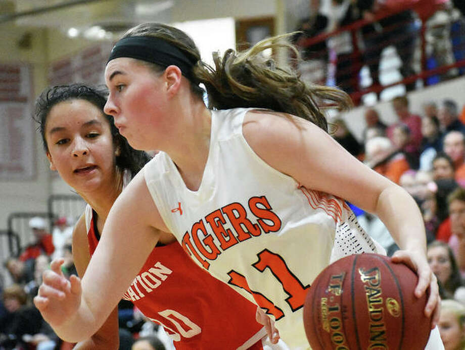 Edwardsville guard Mackenzie Lyerla, right, drives to the basket in the second quarter against Visitation. Photo: Matt Kamp/Intelligencer