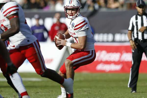 Houston quarterback Clayton Tune (13) looks to pass against Army during the first half of Armed Forces Bowl NCAA college football game Saturday, Dec. 22, 2018, in Fort Worth, Texas. (AP Photo/Jim Cowsert)