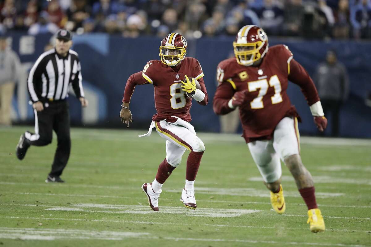 Washington Redskins quarterback Josh Johnson (8) scrambles behind offensive tackle Trent Williams (71) in the second half of an NFL football game against the Tennessee Titans Saturday, Dec. 22, 2018, in Nashville, Tenn. (AP Photo/James Kenney)