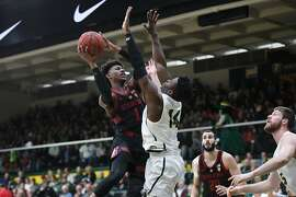 USF forward Charles Minlend guards Daejon Davis of Stanford during a game Saturday, Dec. 23, 2018, at War Memorial Gym.