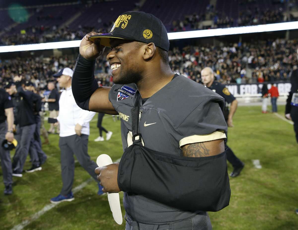 Army quarterback Kelvin Hopkins Jr. smiles as he puts on his championship cap following his team's win over Houston in the Armed Forces Bowl NCAA college football game Saturday, Dec. 22, 2018, in Fort Worth, Texas. Army won 70-14. (AP Photo/Jim Cowsert)