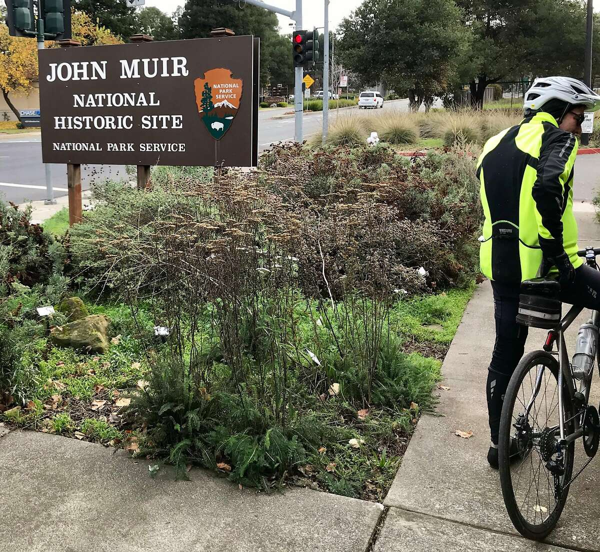 Bicyclist Len Goldschmidt pedals away after finding he can't get into John Muir National Historic Site In Martinez on Saturday afternoon December 22, 2018. Steve Rubenstein/The Chronicle