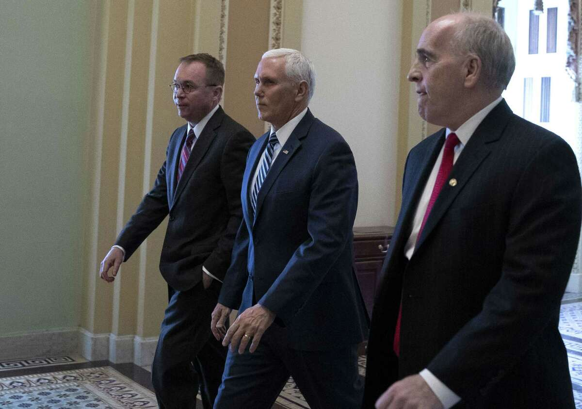 WASHINGTON, DC - DECEMBER 22: Vice President Mike Pence (C) and acting White House Chief of Staff Mick Mulvaney (L) depart the U.S. Capitol on December 22, 2018 in Washington, DC. Pence and Mulvaney were meeting with Senate Minority Leader Chuck Schumer (D-NY). (Photo by Alex Edelman/Getty Images)