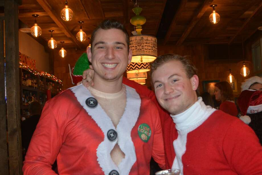 Harbor Point in Stamford hosted first annual Ugly Sweater Bar Crawl, sponsored by Half Full Brewery, on December 22, 2018. Participants donned ugly sweaters and enjoyed drink specials at Sign of the Whale, Mexicue, Bareburger, Fortina and Saltbar. Ticket proceeds benefit Domus Kids Organization, which provides services for high-risk youth in Stamford. Were you SEEN? Photo: Vic Eng / Hearst Connecticut Media Group