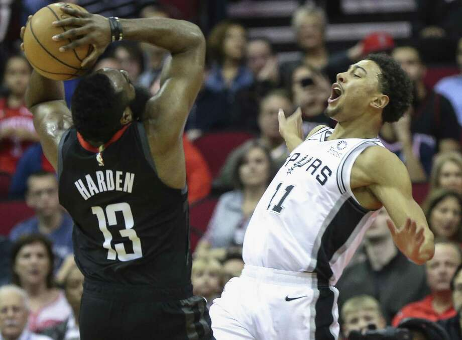 50a1d0d3a77 San Antonio Spurs guard Bryn Forbes (11) fouls on Houston Rockets guard James  Harden
