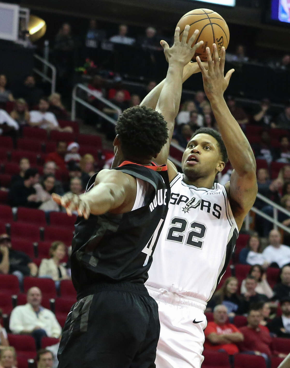 San Antonio Spurs forward Rudy Gay (22) aims for the basket while Houston Rockets forward Danuel House Jr. (4) is trying to stop him during the first quarter of the NBA game at Toyota Center on Saturday, Dec. 22, 2018, in Houston.