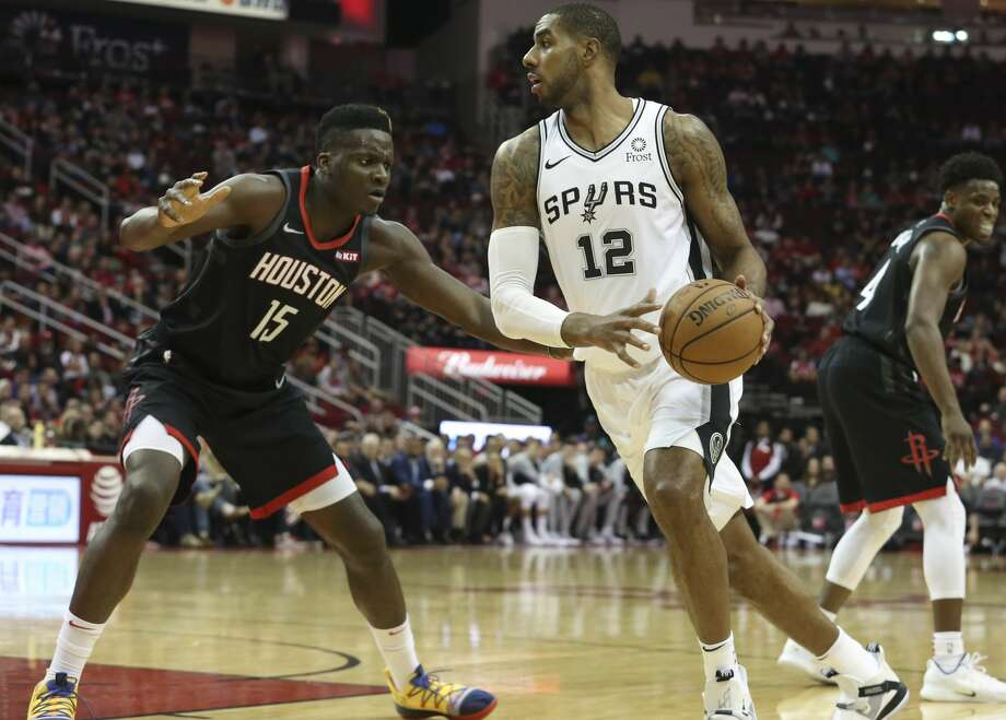 Houston Rockets center Clint Capela (15) defensing San Antonio Spurs forward LaMarcus Aldridge (12) during the first quarter of the NBA game at Toyota Center on Saturday, Dec. 22, 2018, in Houston. Photo: Yi-Chin Lee/Staff Photographer