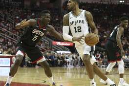 Houston Rockets center Clint Capela (15) defensing San Antonio Spurs forward LaMarcus Aldridge (12) during the first quarter of the NBA game at Toyota Center on Saturday, Dec. 22, 2018, in Houston.