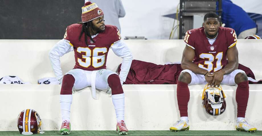 Redskins free safety D.J. Swearinger (36) and cornerback Fabian Moreau (31) sit on the bench following their loss to the Titans at Nissan Stadium on Saturday. Swearinger criticized defensive coordinator Greg Manusky following the loss. MUST CREDIT: Washington Post photo by Jonathan Newton Photo: Jonathan Newton/The Washington Post