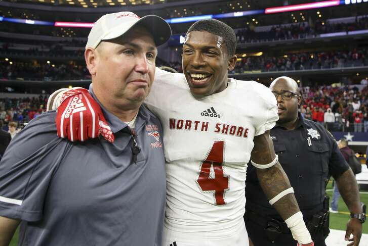 Galena Park North Shore wide receiver A.J. Carter (4) and  head coach Jon Kay celebrate their 6A Division 1 State Championship against Duncanville at AT&T Stadium Saturday, Dec. 22, 2018, in Arlington, Texas. Galena Park North Shore won 41-36.