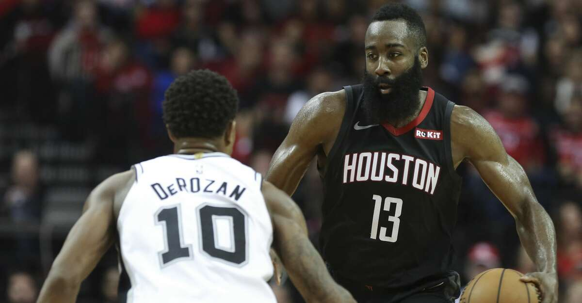 Houston Rockets guard James Harden (13) dribbles while San Antonio Spurs guard DeMar DeRozan (10) is defensing during the third quarter of the NBA game at Toyota Center on Saturday, Dec. 22, 2018, in Houston. The Houston Rockets defeated the San Antonio Spurs 108-101.