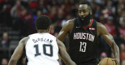 01981443a22c Houston Rockets guard James Harden (13) dribbles while San Antonio Spurs  guard DeMar DeRozan (10) is defensing during the third quarter of the NBA  game at ...