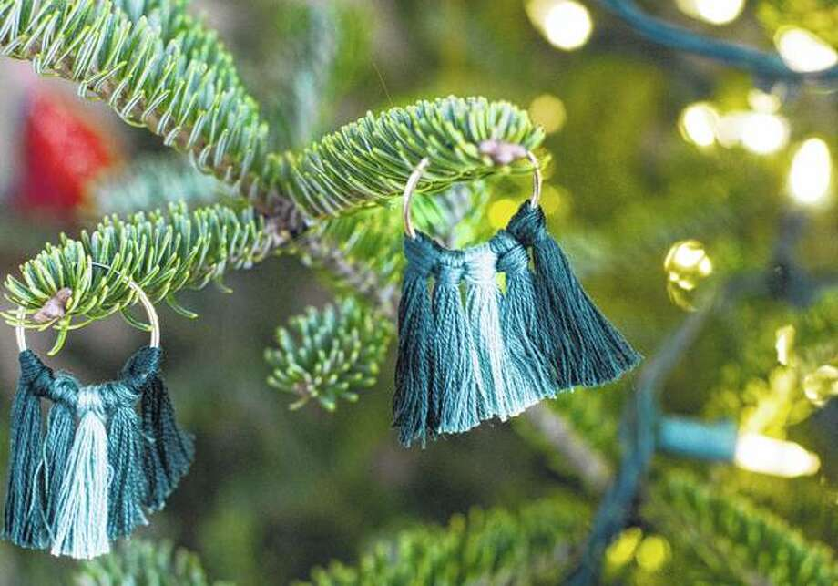 Handmade earrings are both inexpensive and fairly simple to create. These combine two trends — tassels and an ombre color pattern. Photo: Holly Ramer   Associated Press
