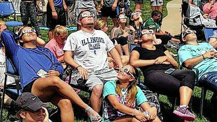 Illinois College students turn their attention skyward during a complete solar eclipse in 2017. Photo: Nick Draper | Journal-Courier