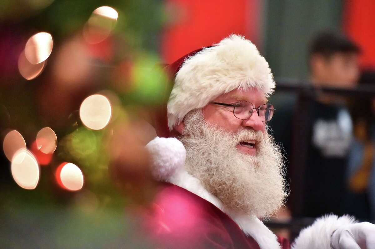 Santa Claus makes an appearance during the HEB Feast of Sharing Holiday Dinner at the Henry B. Gonzalez Convention Center Saturday. HEB officials estimated that they would feed 10,000-12,000 people at the event.