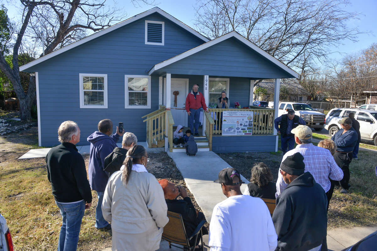 Friends gather to welcome Katie Cole to her new home that members of the community built to replace her West End home that suffered extensive damage in a fire.