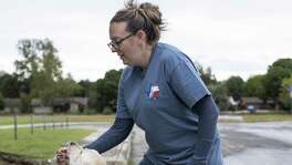 Jamie Massey, director of training at Guide Dogs of Texas, rewards her guide dog in-training Ike with a treat as he stops and alerts her before climbing a step in front of him and continuing on, outside of the Guide Dogs of Texas training facility in San Antonio on Friday, November 9, 2018. The guide dogs must be able to alert their legally blind owners of such obstacles as they appear.