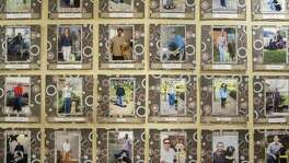 Photographs of Guide Dogs of Texas's clients along with their service dogs line the wall of the company's office in San Antonio on Friday, November 9, 2019. Guide Dogs of Texas has been operating since 1989 and serviced the blind with over 230,000 days of guided sight.