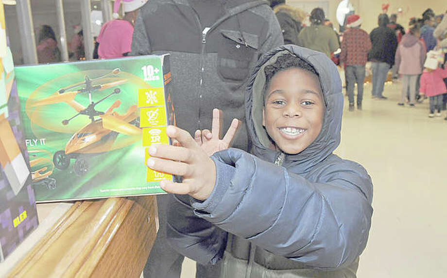 Eight-year-old My'Khem Love found just the right toy on Saturday night. Photo: David Blanchette | For The Telegraph
