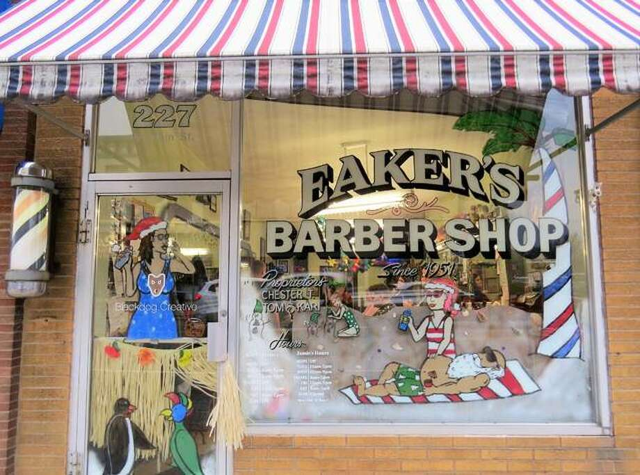 Eaker's Family Barbershop was recently named as the winner of the Edwardsville Parks and Recreation Department's 2018 Downtown Window Decorating Contest. The business, located at 227 N. Main St., painted their holiday window design, featuring Santa Claus lounging on a beach. Photo: Carol Arnett | For The Intelligencer