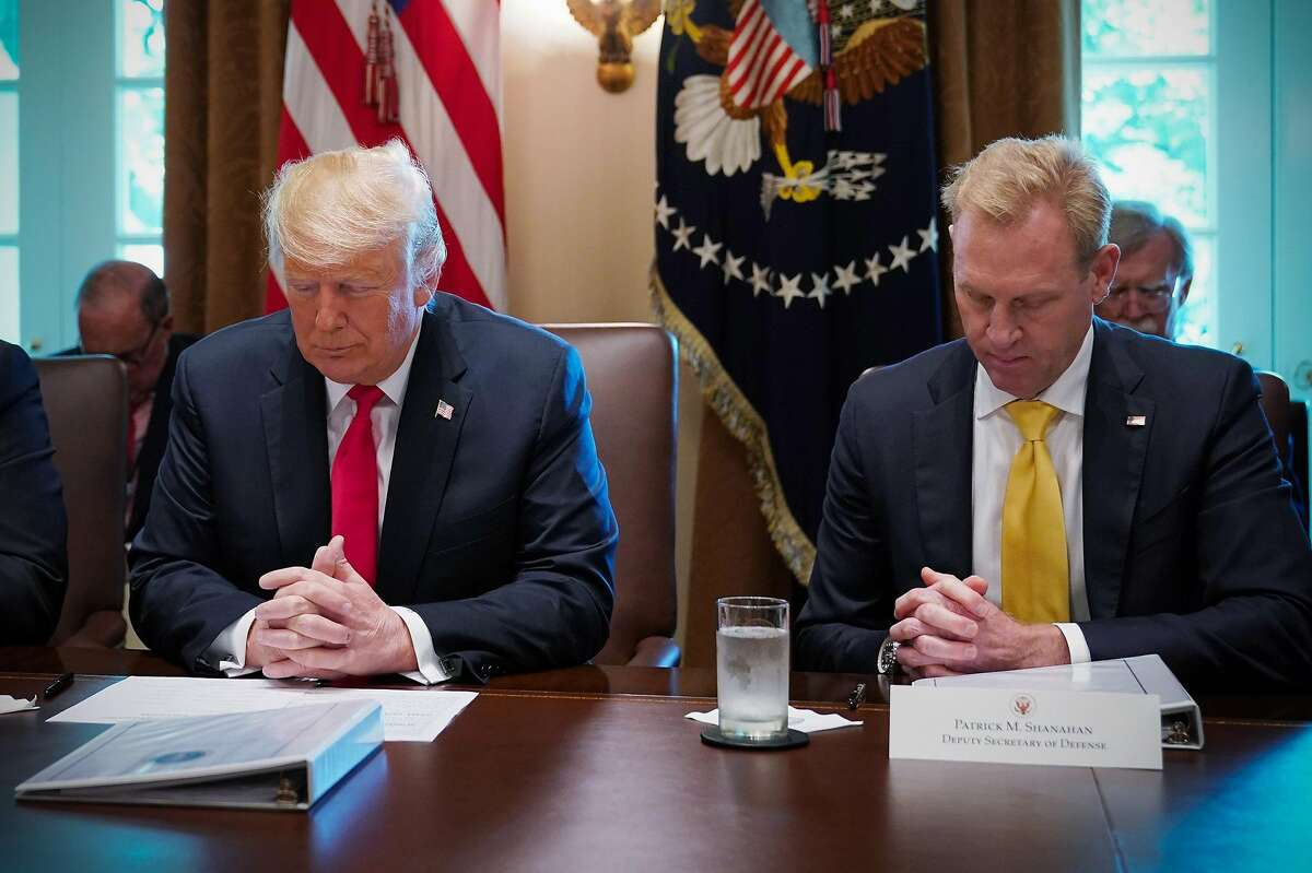 """(FILES) In this picture dated August 16, 2018 in Washington, DC US President Donald Trump and Deputy Secretary of Defense Patrick Shanahan (R), bow their heads in prayer before the start of a Cabinet meeting in the Cabinet Room of the White House . - Donald Trump on December 23, 2018 announced he would replace Defense Secretary Jim Mattis with his deputy Patrick Shanahan, days after the outgoing Pentagon chief quit while citing key policy differences with the US president. """"I am pleased to announce that our very talented Deputy Secretary of Defense, Patrick Shanahan, will assume the title of Acting Secretary of Defense starting January 1, 2019,"""" the Republican leader tweeted, accelerating Mattis's planned departure by two months. (Photo by MANDEL NGAN / AFP)MANDEL NGAN/AFP/Getty Images"""