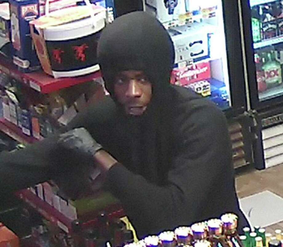 Midland Police Department needs help identifying two suspects involved in an aggravated robbery that occurred at Erin's Liquor Store No. 2, 1317 N. Lamesa Road on Dec. 4. Two males entered the store and robbed it at gunpoint.  Photo: Midland Crime Stoppers