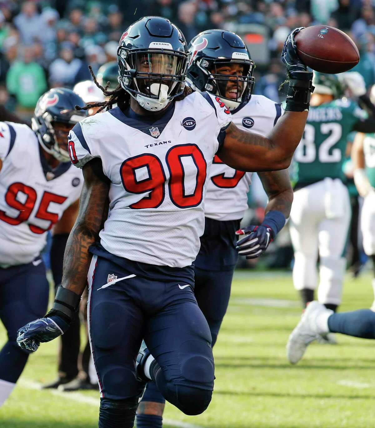 Houston Texans outside linebacker Jadeveon Clowney (90) celebrates his fumble recovery after sacking Philadelphia Eagles quarterback Nick Foles during the first half of an NFL football game at Lincoln Financial Field on Sunday, Dec. 23, 2018, in Philadelphia.