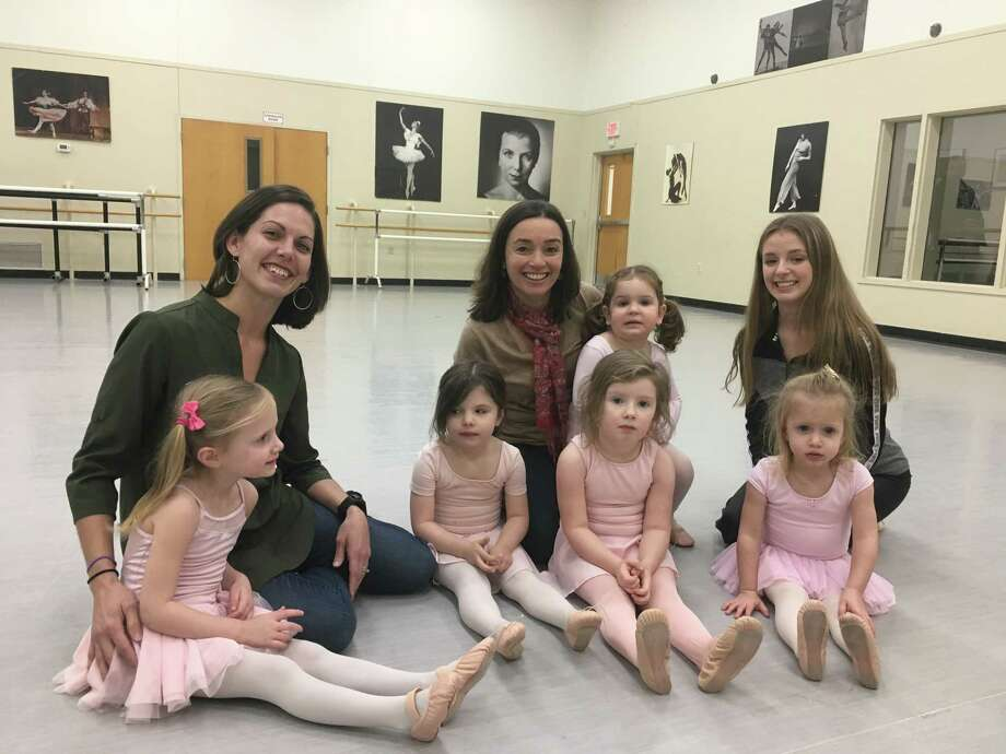School of the Arts Co-directors Joan Anderson and Cristiane Santos sit with students from the National Museum of Dance School of the Arts students, from left, Ella Dobies, Olivia Conklin, Eve Cornish, Stella Zuppa (on Santos lap), Alexandra Nicolaus and Reese Dobies in one of the school's studios on Dec. 21, 2018. (Wendy Liberatore/times Union) Photo: Wendy Liberatore/Times Union